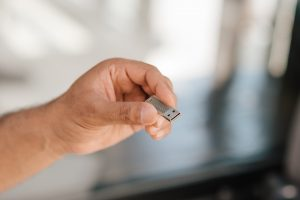 a person holding a USB