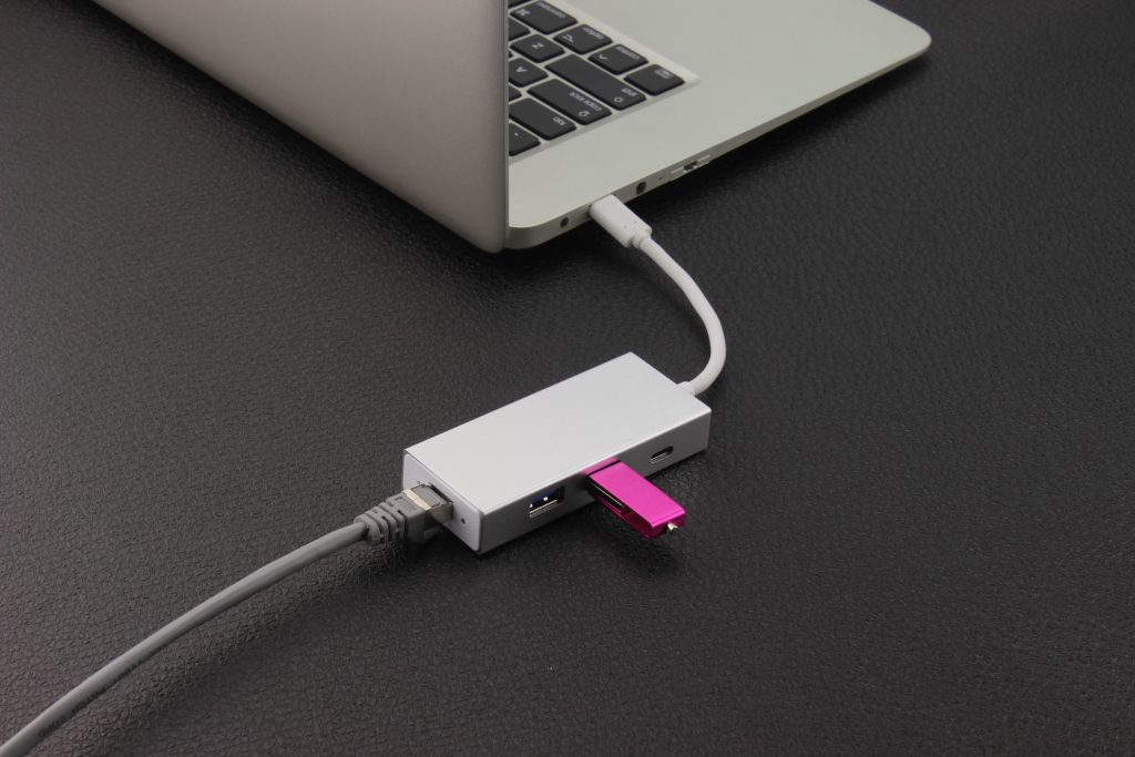 a pink USB drive inserted in a USB port adaptor